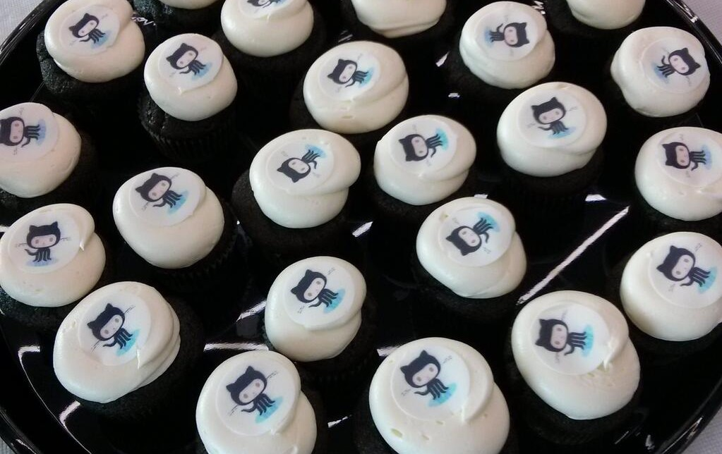 "A tray of ""Octocakes"" thanks to GitHub. Image courtesy of @bluesmoon."